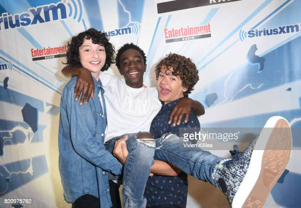 Finn Wolfhard Caleb McLaughlin and Gaten Matarazzo attend SiriusXM's Entertainment Weekly Radio Channel Broadcasts From Comic Con 2017 at Hard Rock...