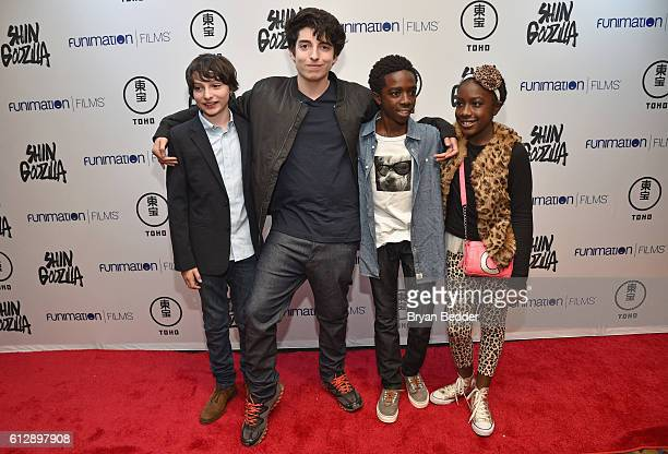 Finn Wolfhard Nick Wolfhard Caleb McLaughlin and Caitlyn McLaughlin attend the 'Shin Godzilla' premiere presented by Funimation Films at AMC Empire...