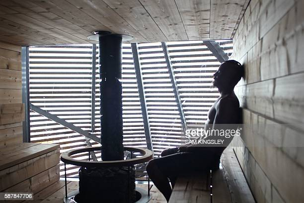 Finnish actor Jasper Paakkonen relaxes inside the trendy new boutique sauna called Loyly in Helsinki on July 07 2016 In Finland despite an astounding...