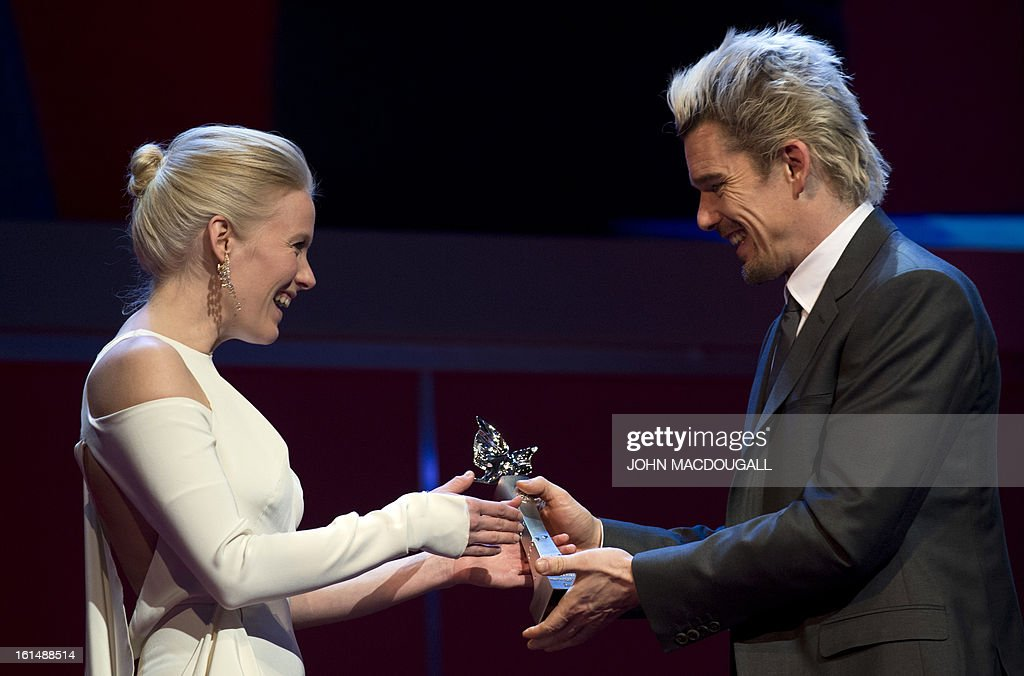 Finnish actress Laura Birn receives her Shooting Star award from US actor Ethan Hawke during the 63rd Berlinale Film Festival in Berlin February 11, 2013. The Shooting Star awards reward Europe's best young promising actors.