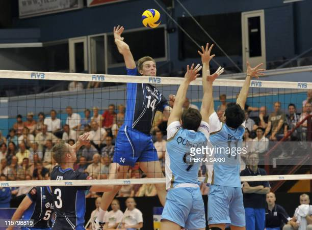 Finnish Antti Siltala Mikko Esko Konstantin Shomov compete against Argentinean Roddrigo Quiroga and Sebastian Sole during the World League volleyball...