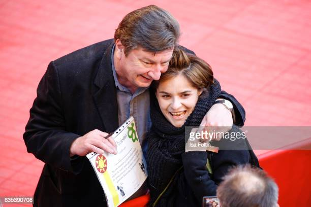 Finnish director and screenwriter Aki Kaurismaki with a fan during the 'The Other Side of Hope' premiere during the 67th Berlinale International Film...