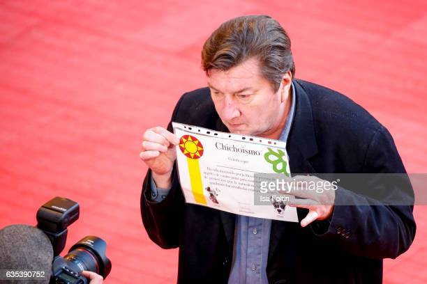 Finnish director and screenwriter Aki Kaurismaki with an animal protection flyer during the 'The Other Side of Hope' premiere during the 67th...