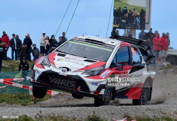 Finnish driver and codriver Jari Matti Latvala and Miikka Anttila steer their Toyota Yaris WRC in Viana do Castelo northern Portugal on May 19 during...
