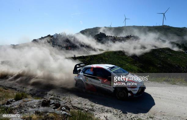 Finnish driver and codriver Jari Matti Latvala and Miikka Anttila steer their Toyota Yaris WRC in Caminha northern Portugal on May 19 during the...