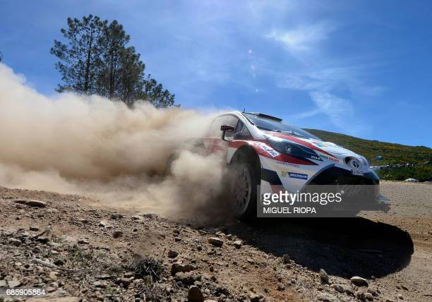 Finnish driver and codriver Jari Matti Latvala and Miikka Anttila steer their Toyota Yaris WRC in Amarante northern Portugal on May 20 during the...