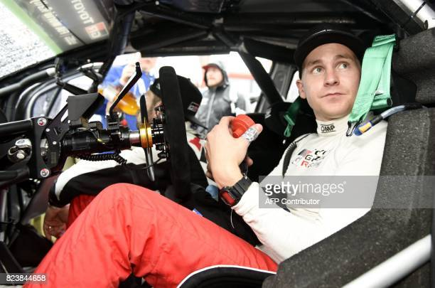 Finnish driver Esapekka Lappi sits in the cockpit of his Toyota Yaris WRC during a service break at the Neste Rally Finland in Jyväskylä Finland on...