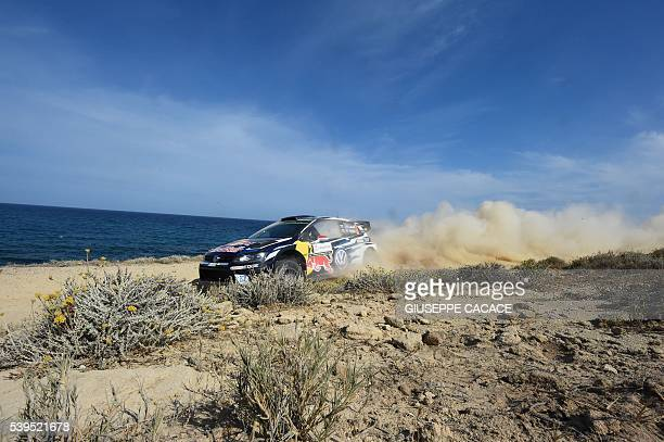 TOPSHOT Finnish driver Jari Matti Latvala and Finish codriver Miikka Anttila drive their Volkswagen Polo R WRC near Alghero on the fourth day of the...