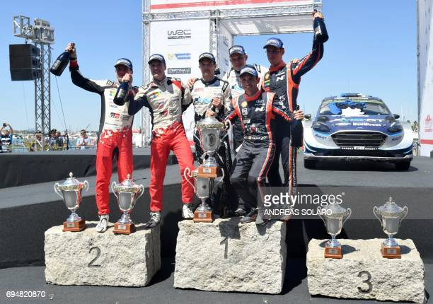 Finnish driver JariMatti Latvala and compatriot codriver Miikka Anttila of Toyota Yaris WRC Estonian driver Ott Tanak and his compatriot codriver...