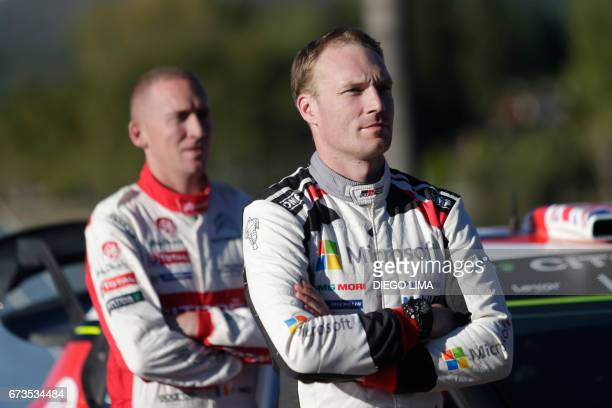 Finnish driver JariMatti Latvala and Kris Meeke's codriver Paul Nagle from Ireland pose for a photoshoot inside the service park area of the World...