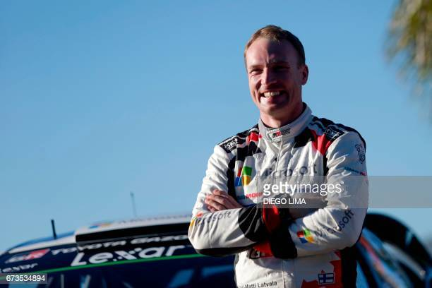 Finnish driver JariMatti Latvala smiles as he poses for a photoshoot inside the service park area of the World Rally Championship Argentina 2017...
