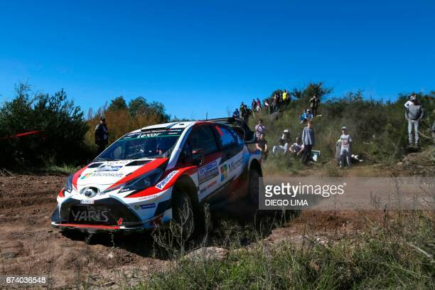 Finnish driver JariMatti Latvala steers his Toyota Yaris WRC with his compatriot codriver Miikka Anttila during the shakedown stage of the WRC...