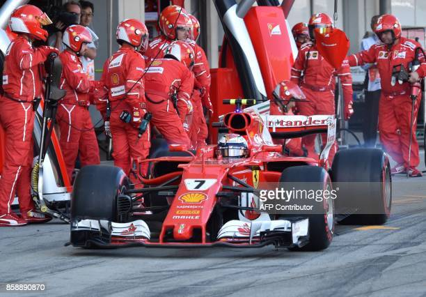 Finnish driver Kimi Raikkonen leaves the pit during the Formula One Japanese Grand Prix at Suzuka on October 8 2017 / AFP PHOTO / POOL / Kazuhiro...