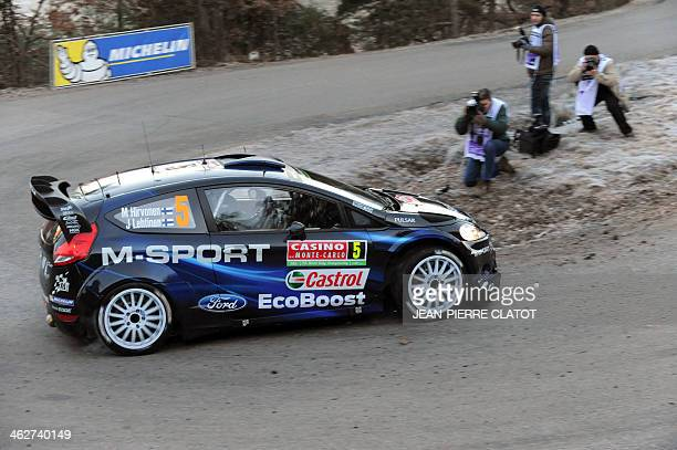 Finnish driver Mikko Hirvonen steers his Ford Fiesta RS on January 15 2014 in Chateauvieux southeastern France during the shakedown of the MonteCarlo...