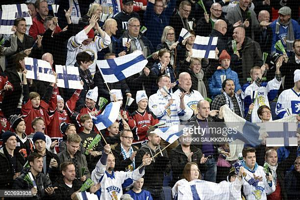 Finnish fans celebrate a goal during the 2016 IIHF World Junior Ice Hockey Championship match between Russia and Finland in Helsinki Finland on...
