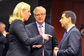 Finnish Finance Minister Jutta Urpilainen talks to Portuguese finance minister Vitor Gaspar eyed by EU Commissioner for Economic and Monetary Affairs...