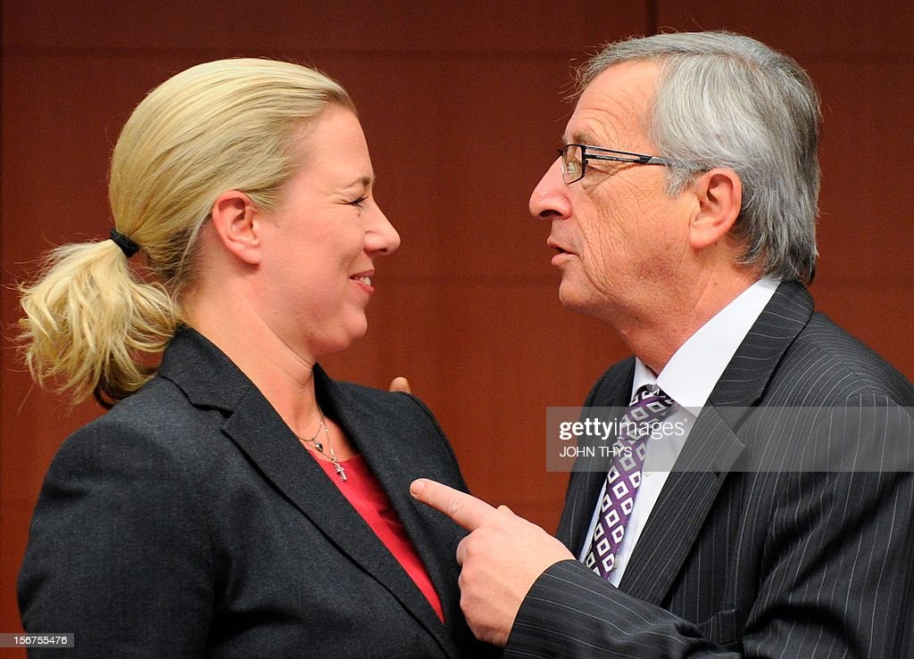 Finnish Finance Minister Jutta Urpilainen (L) talks with Prime Minister and President of the Eurogroup Council Jean-Claude Juncker (R) before a Eurozone finance ministers meeting to decide on a fresh rescue loan for debt-stricken Greece, on November 20, 2012 at EU headquarters in Brussels. Greece has 'delivered' on reform and a deal will likely be clinched to unblock funds to keep it from bankruptcy, the head of the Eurogroup insisted despite a split with the IMF over how to get the stricken country's economic recovery on track.
