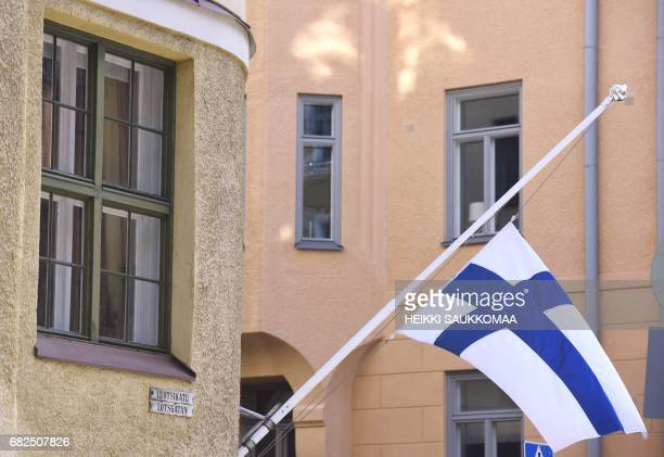 Finnish flag on the halfmast outside the home building of the former Finnish President Mauno Koivisto in Helsinki early on May 13 2017 The former...