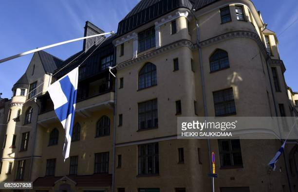 Finnish flag on the halfmast outside the home building of the former Finnish President Mauno Koivisto early on May 13 2017 in Helsinski The former...