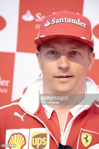 Finnish Formula One driver Kimi Raikkonen of Ferrari poses at a media meeting of his sponsor Santander Bank in Helsinki Finland on August 22 2017...