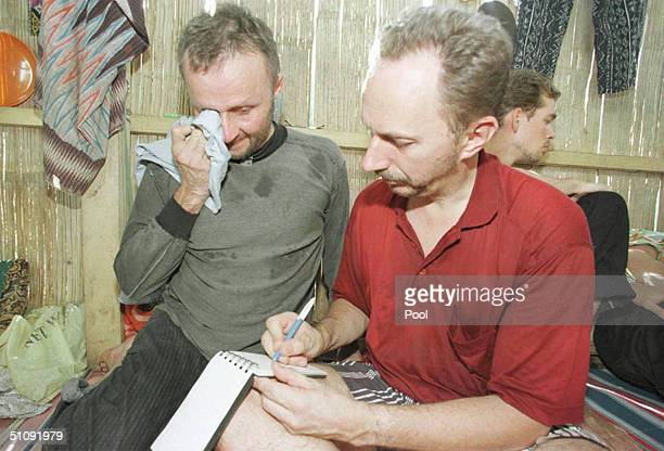 Finnish Hostage Juhani Sappo Franti Left Weeps While Mirco Jahanen Risto Scribbles A Note To Their Embassy Inside A Hut At Their Kidnapper's Hideout...