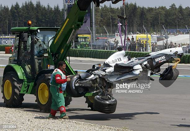 Finnish McLarenMercedes driver Kimi Raikkonen's car is lifted by a tractor after he crashed on the Hockenheim racetrack 03 August 2003 after the...