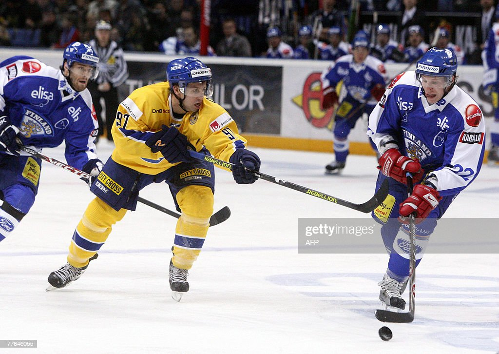Finnish Mika Pyrl and Swedish Per Ledin play in the icehockey Euro Hockey Tour match Finland vs Sweden in Helsinki 11 November 2007 Rear is Finnish...