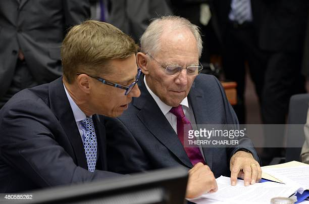 Finnish Minister of Finance Alexander Stubb speaks with German Minister of Finance Wolfgang Schauble prior to the start of the Eurogroup meeting...