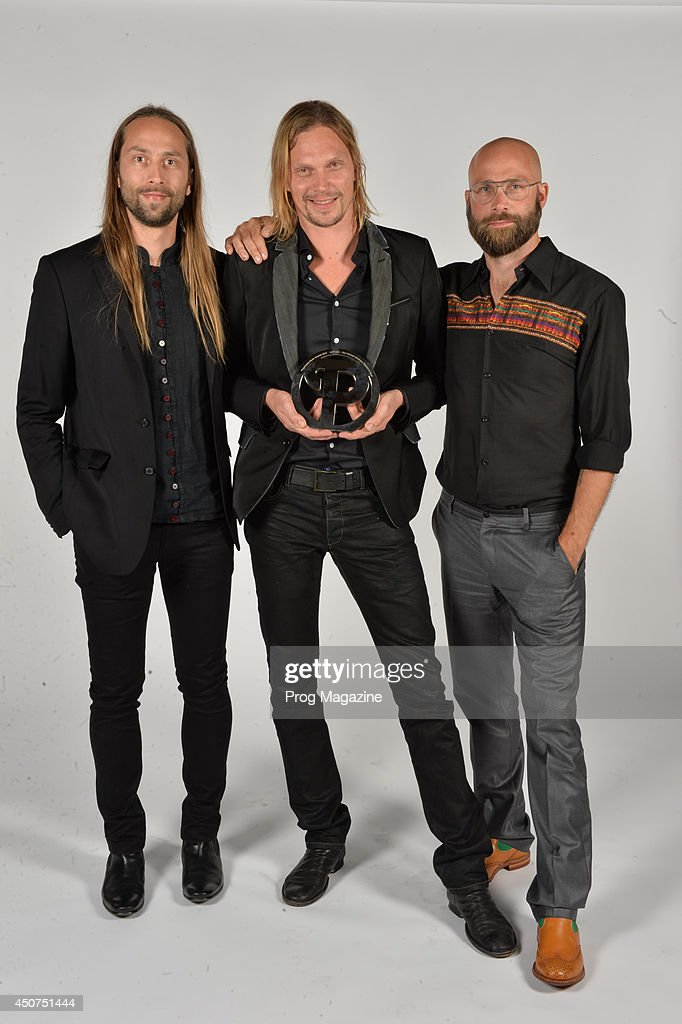 Finnish musicians (L-R) Jonne von Hertzen, Mikko von Hertzen and Kie von Hertzen photographed after winning the Anthem Award at the 2013 Progressive Music Awards at Kew Gardens in London, on September 3, 2013.