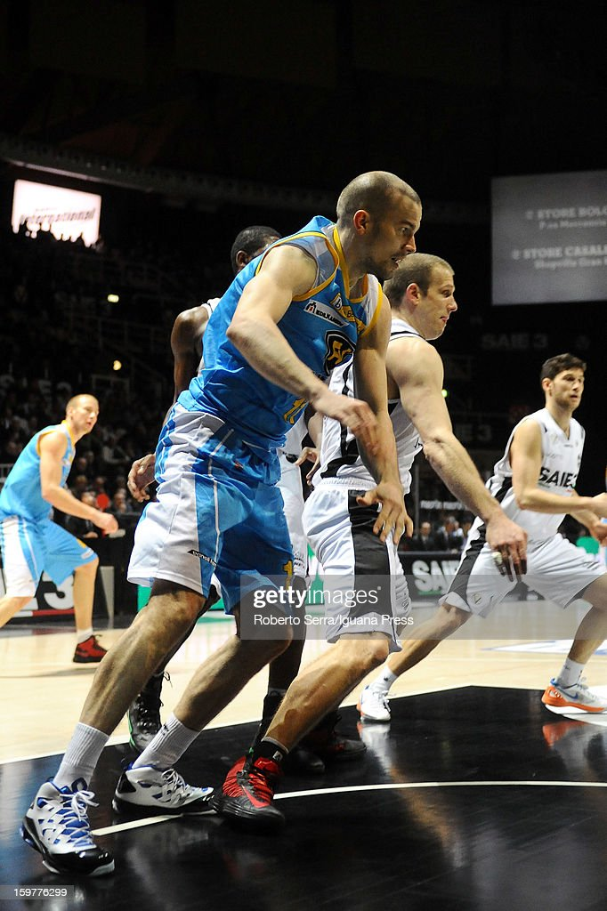 Finnish player Tukka Kotti of Vanoli competes with Mason Rocca of SAIE3 during the LegaBasket Serie A match between Virtus SAIE3 Bologna and Vanoli Cremona at Futurshow Station on January 20, 2013 in Bologna, Italy.