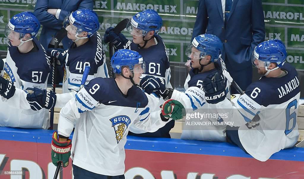 Finnish players celebrate a goal during the group B preliminary round game Finland vs Belarus at the 2016 IIHF Ice Hockey World Championship in St. Petersburg on May 6, 2016. / AFP / ALEXANDER