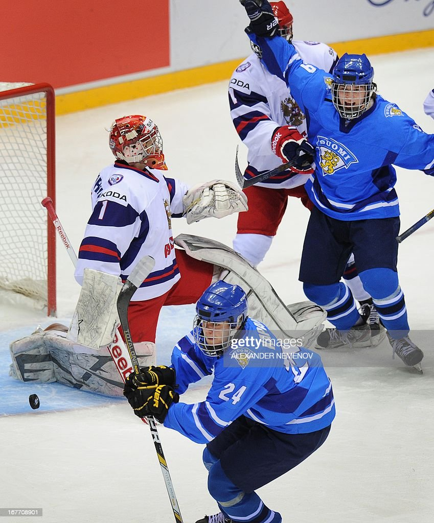 Finnish players celebrate after scoring a goal against team Russia during their bronze medal game of the IIHF U18 International Ice Hockey World Championship in Sochi on April 28, 2013.