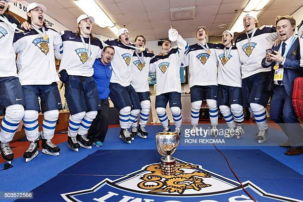 Finnish players celebrate winning the world championship with the trophy in the locker room after the end of the 2016 IIHF World Junior Ice Hockey...