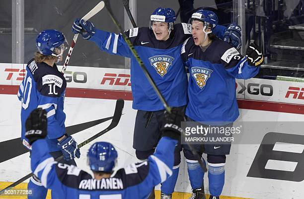 Finnish players Roope Hintz Mikko Rantanen Joni Tuulola and Antti Kalapudas celebrate the 22 goal during the 2016 IIHF World Junior Ice Hockey...