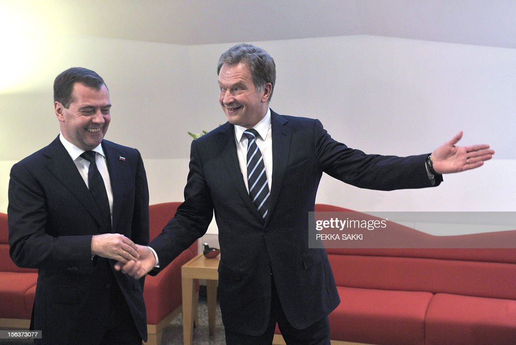Finnish President Sauli Niinistö (R) shows the way to Russian Prime Minister Dmitri Medvedev as they meet at the Presidential residence Mäntyniemi, in Helsinki, on November 14t, 2012.