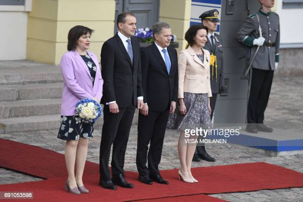 Finnish President Sauli Niinisto and his wife Jenni Haukio welcome the President of Iceland Gudni Johannesson and his wife Eliza Reid in front of the...