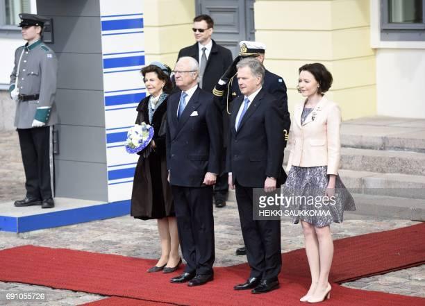 Finnish President Sauli Niinisto and his wife Jenni Haukio welcome King Carl XVI Gustaf of Sweden and his wife Queen Silvia of Sweden in front of the...