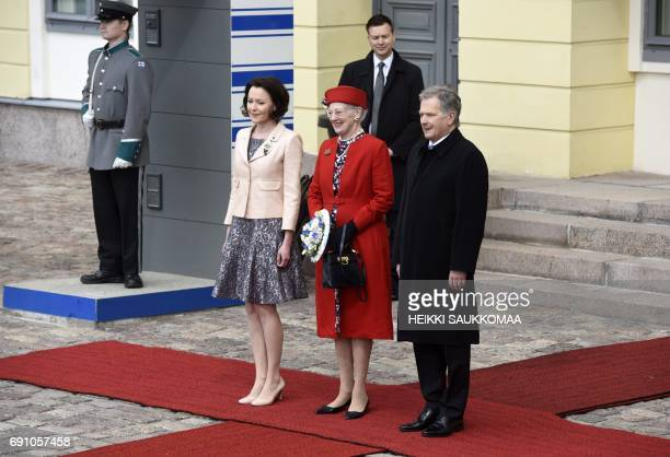 Finnish President Sauli Niinisto and his wife Jenni Haukio welcome Queen Margrethe II of Denmark in front of the Presidential palace during the visit...