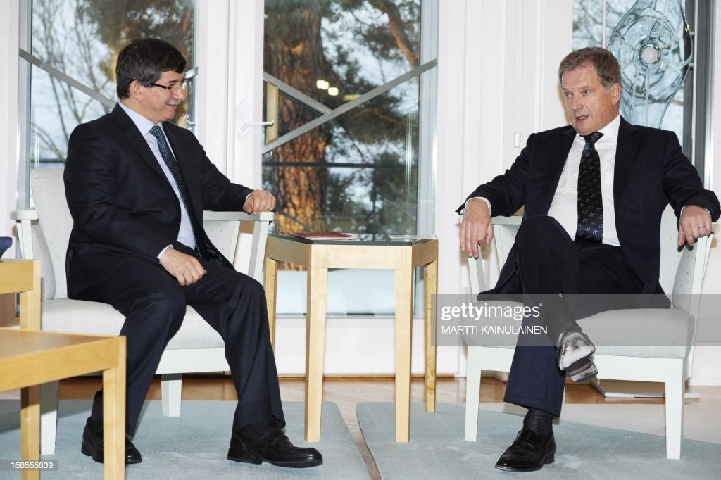 Finnish President Sauli Niinisto (R) meets Turkish Foreign Minister Ahmet Davutoglu in Helsinki, Finland, on December 19, 2012. AFP PHOTO / LEHTIKUVA / Martti Kainulainen