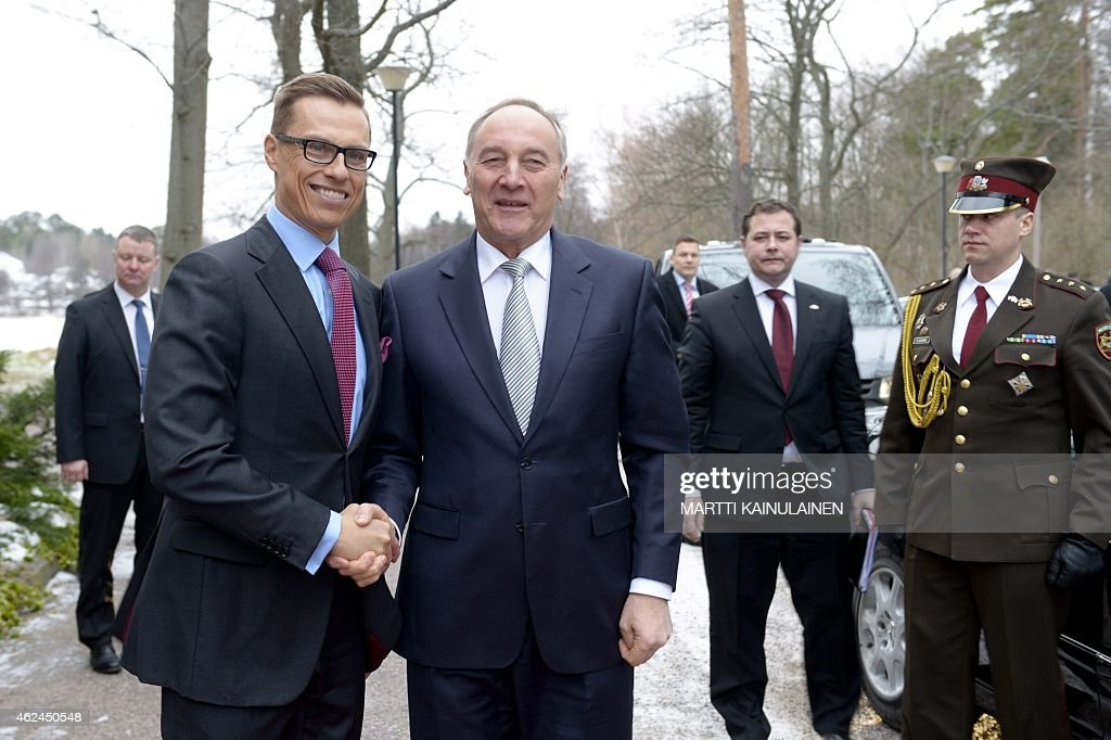 Finnish Prime Minister <a gi-track='captionPersonalityLinkClicked' href=/galleries/search?phrase=Alexander+Stubb&family=editorial&specificpeople=2157393 ng-click='$event.stopPropagation()'>Alexander Stubb</a> (L) and Latvian President Andris Berzins shake hands as they meet at the Prime Minister's official residence Kesäranta in Helsinki, Finland, on January 29, 2015. AFP PHOTO / LEHTIKUVA / Martti Kainulainen