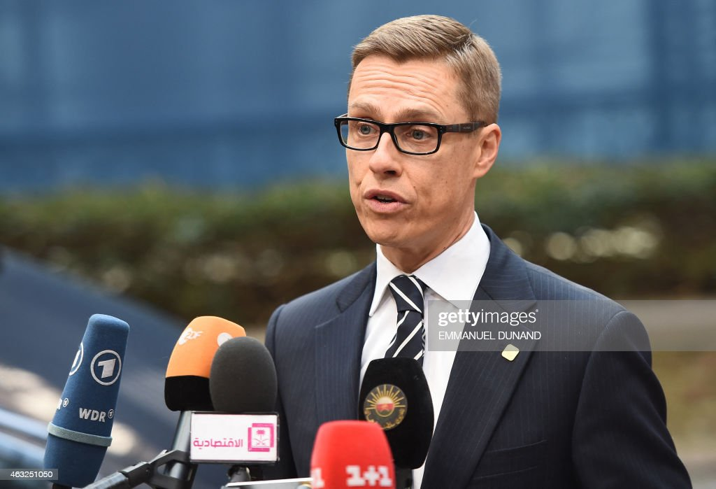 Finnish Prime Minister <a gi-track='captionPersonalityLinkClicked' href=/galleries/search?phrase=Alexander+Stubb&family=editorial&specificpeople=2157393 ng-click='$event.stopPropagation()'>Alexander Stubb</a> speaks to journalists as he arrives ahead of the European Council Summit at the European Union (EU) Headquarters in Brussels on February 12, 2015.
