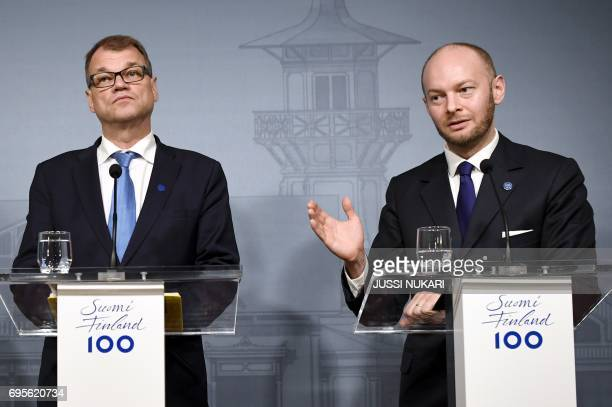 Finnish Prime Minister Centre Party chairman Juha Sipilae and minister Sampo Terho from the New Alternative attend a press conference at the Prime...