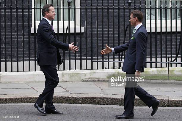 Finnish Prime Minister Jyrki Katainen is greeted by British Prime Minister David Cameron outside Number 10 Downing Street on March 30 2012 in London...