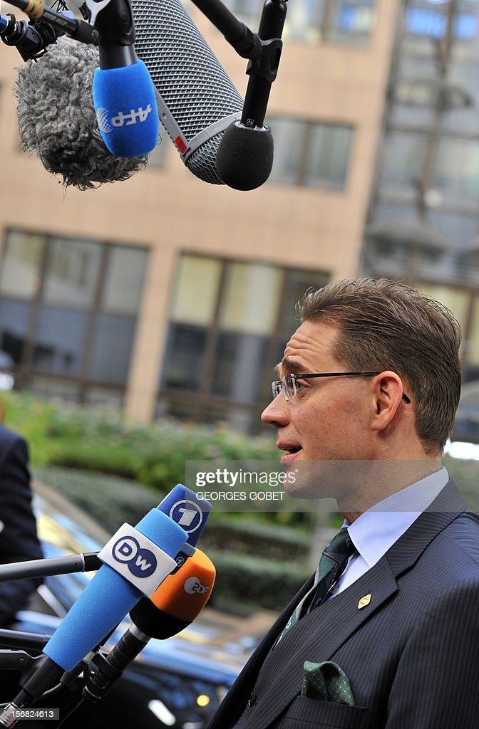Finnish Prime Minister Jyrki Katainen talks to journalists as he arrives at the EU Headquarters on November 22, 2012 in Brussels, to take part in a two-day European Union leaders summit called to agree a hotly-contested trillion-euro budget through 2020. European Union officials were scrambling to find an all but impossible compromise on the 2014-2020 budget that could successfully move richer nations looking for cutbacks closer to poorer ones who look to Brussels to prop up hard-hit industries and regions.