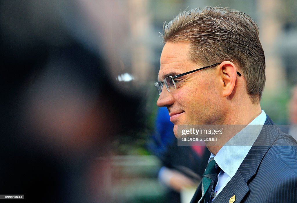 Finnish Prime Minister Jyrki Katainen talks to journalists as he arrives at the EU Headquarters on November 22, 2012 in Brussels, to take part in a two-day European Union leaders summit called to agree a hotly-contested trillion-euro budget through 2020. European Union officials were scrambling to find an all but impossible compromise on the 2014-2020 budget that could successfully move richer nations looking for cutbacks closer to poorer ones who look to Brussels to prop up hard-hit industries and regions. AFP PHOTO / GEORGES GOBET