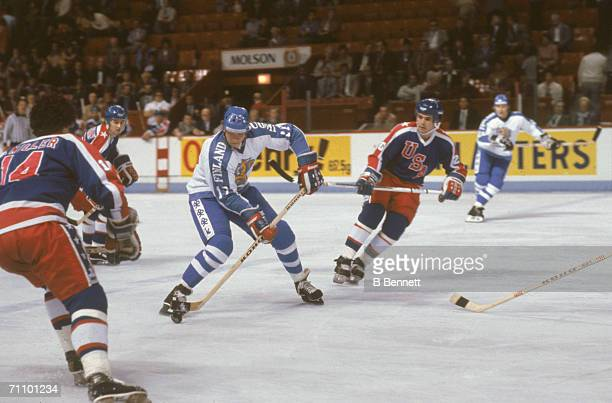 Finnish professional hockey player Jari Kurri right wing for Edmonton Oilers and playing for Team Finland prepares to hit the puck during a game with...