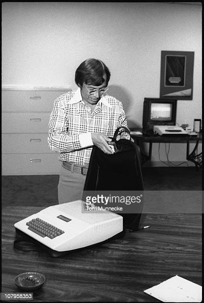 FinnishAmerican businessman Mike Markkula poses with the first Apple II computer and its carrying case April 1977 Markkula was one the first...