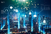 'Fintech' word on digital virtual screen with futuristic city skyline. Hi-tech business concept .