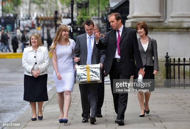Fiona Bruce MP newly weds Esther and Rhys Curnow David Burrows MP and Dr Sharon James arrive in Downing Street London carrying a box representing a...