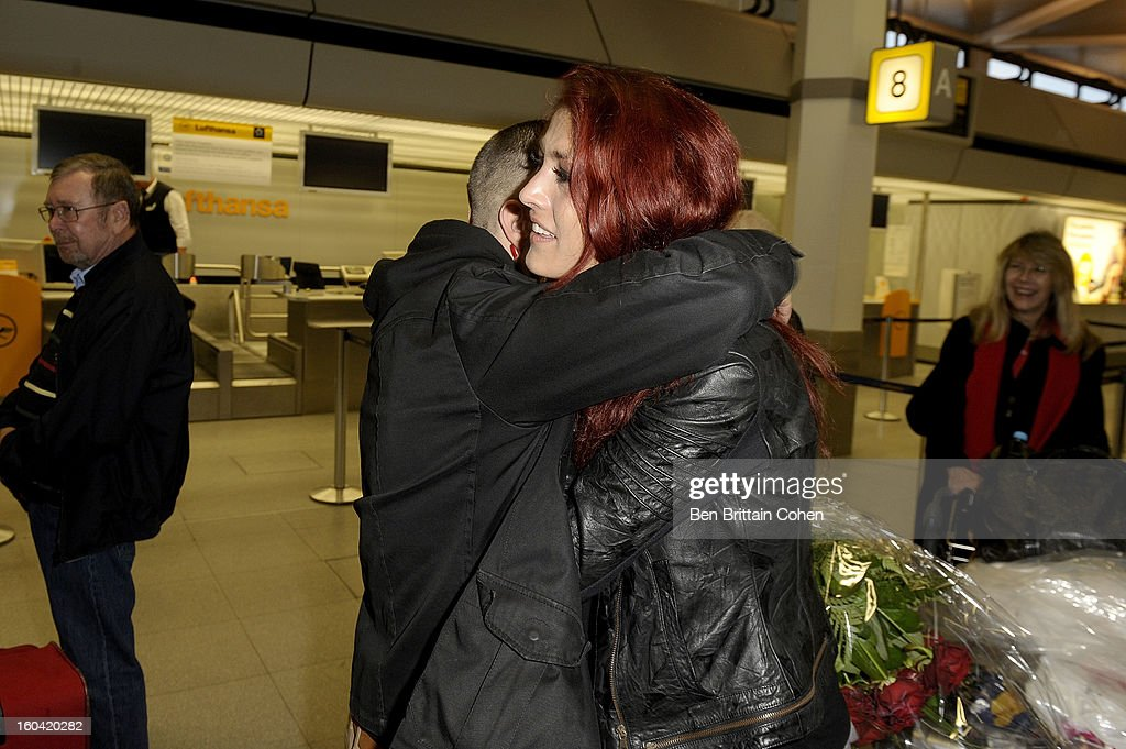 <a gi-track='captionPersonalityLinkClicked' href=/galleries/search?phrase=Fiona+Erdmann&family=editorial&specificpeople=4605078 ng-click='$event.stopPropagation()'>Fiona Erdmann</a> and husband Mohammed pose after arriving at the Airport Berlin Tegel after spending two weeks in the Australian Outback on January 29, 2013 in Berlin, Germany. The German celebrity were participant in the 2013- RTL-TV-Show 'Dschungelcamp' - Ich bin ein Star - Holt mich hier raus!.